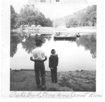 vintage photo of two boys standing by river