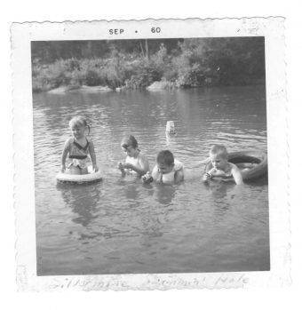 vintage photo of kids swimming in river