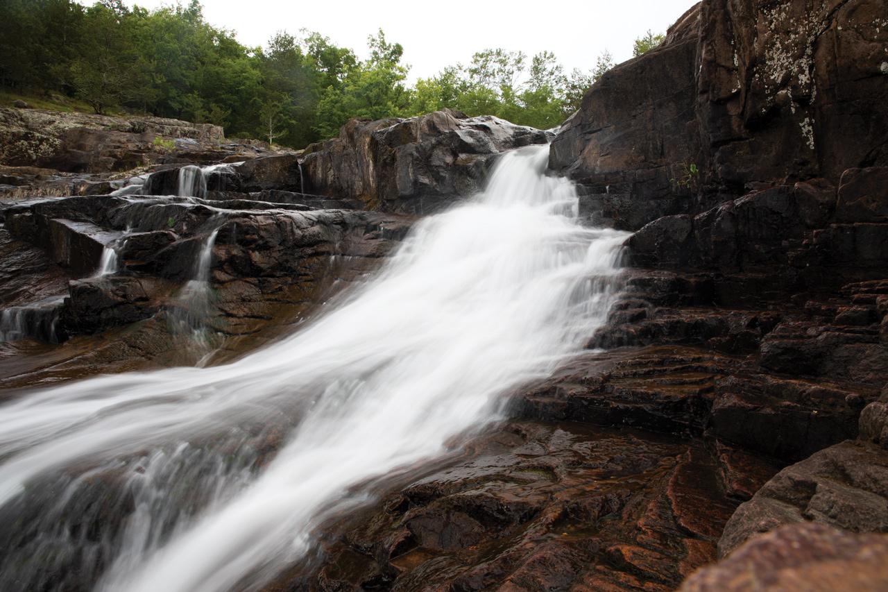 spring water rushing down rocks