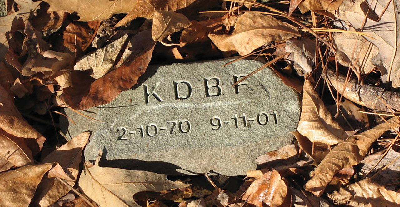 memorial stone with leaves