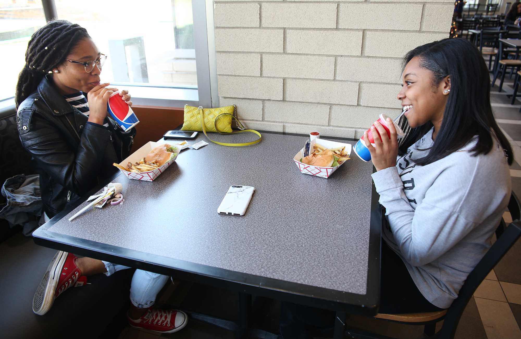 two students eat lunch at The MARK