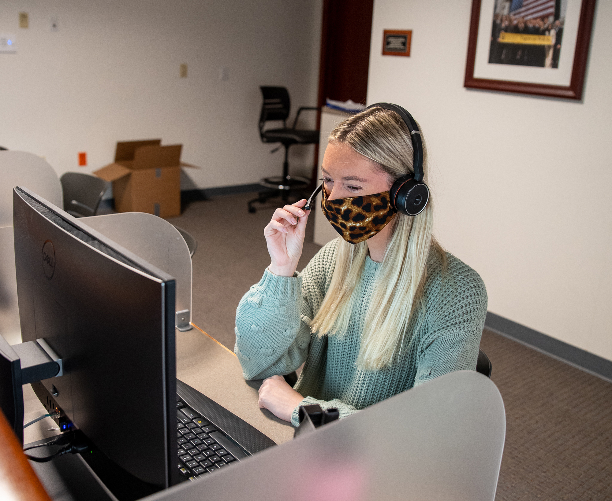 student on the phone in the inside sales lab