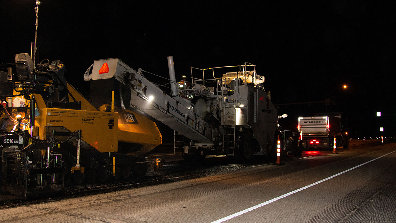 An asphalt paving machine prepares to receive new asphalt paving material made with recycled plastic while resurfacing a portion of Stadium Boulevard in Columbia.