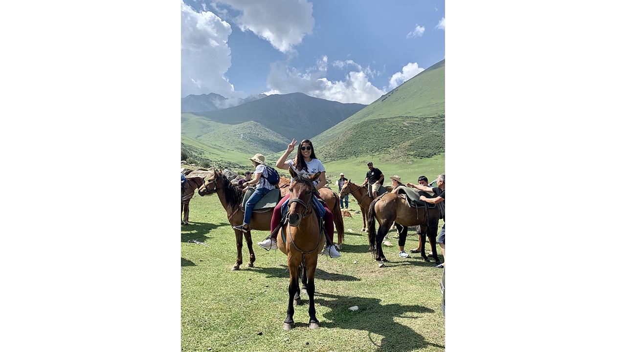 a student rides a horse