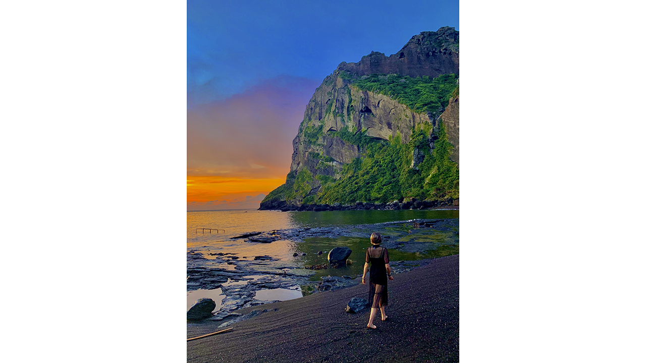 a student on a sunset beach