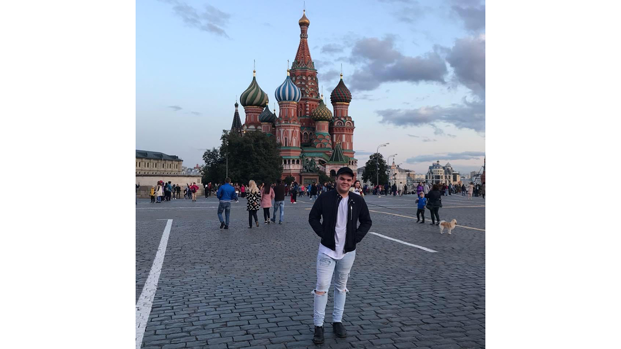a man stands in front of a russian monument