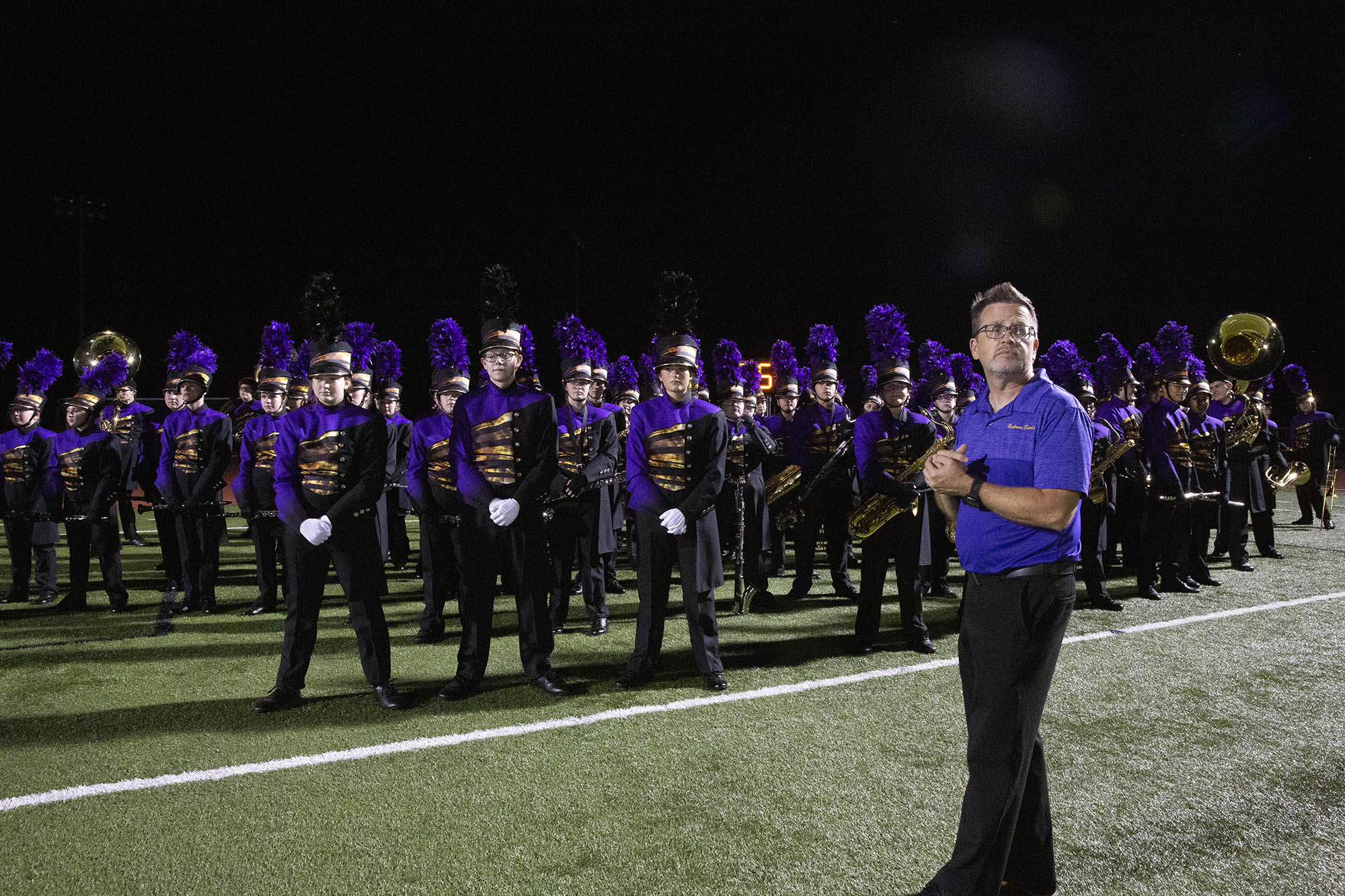 denis swope looks on with the hickman marching band behind him