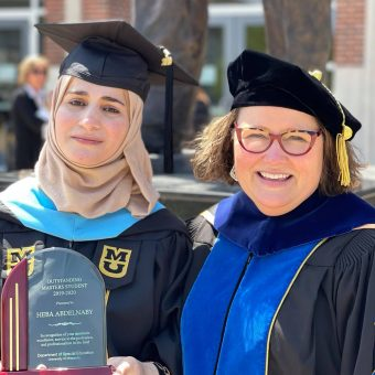 photo of a student and her dean at graduation