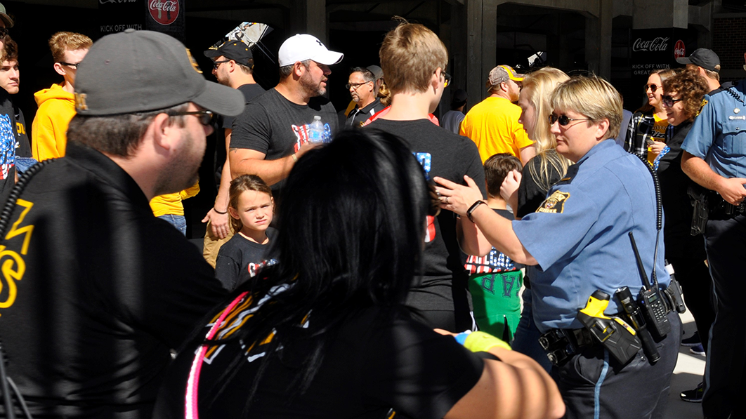 This is an image of MUPD officers ushering fans into the Memorial Stadium.