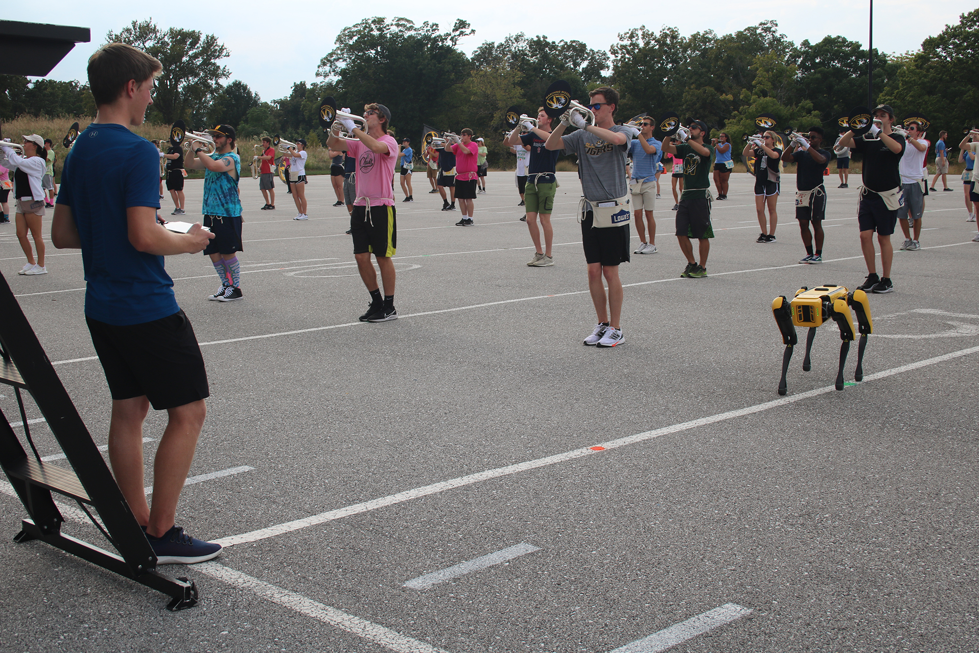 photo of nate beatti controlling spot during a marching band rehearsal