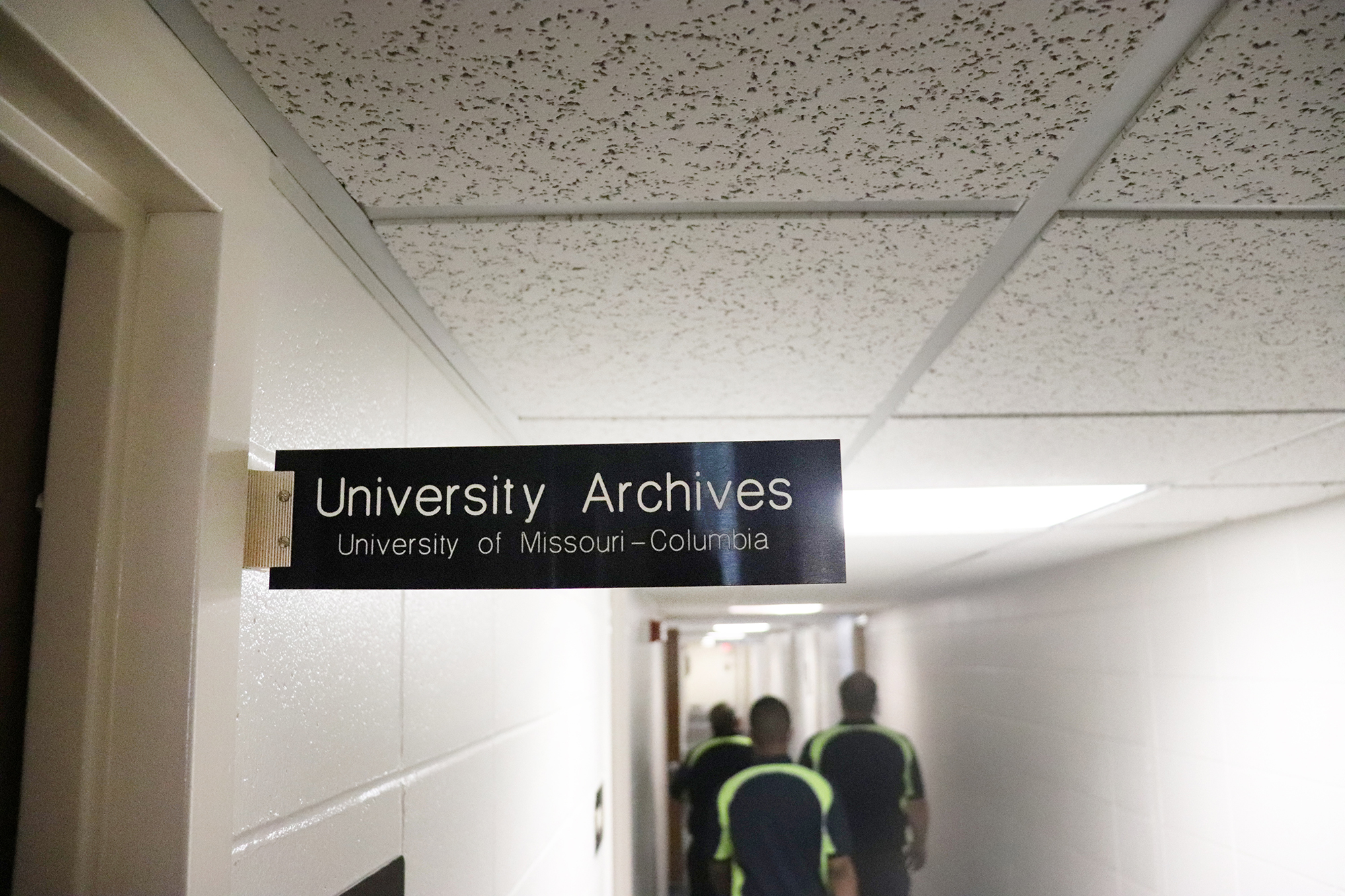 university archives sign in a building