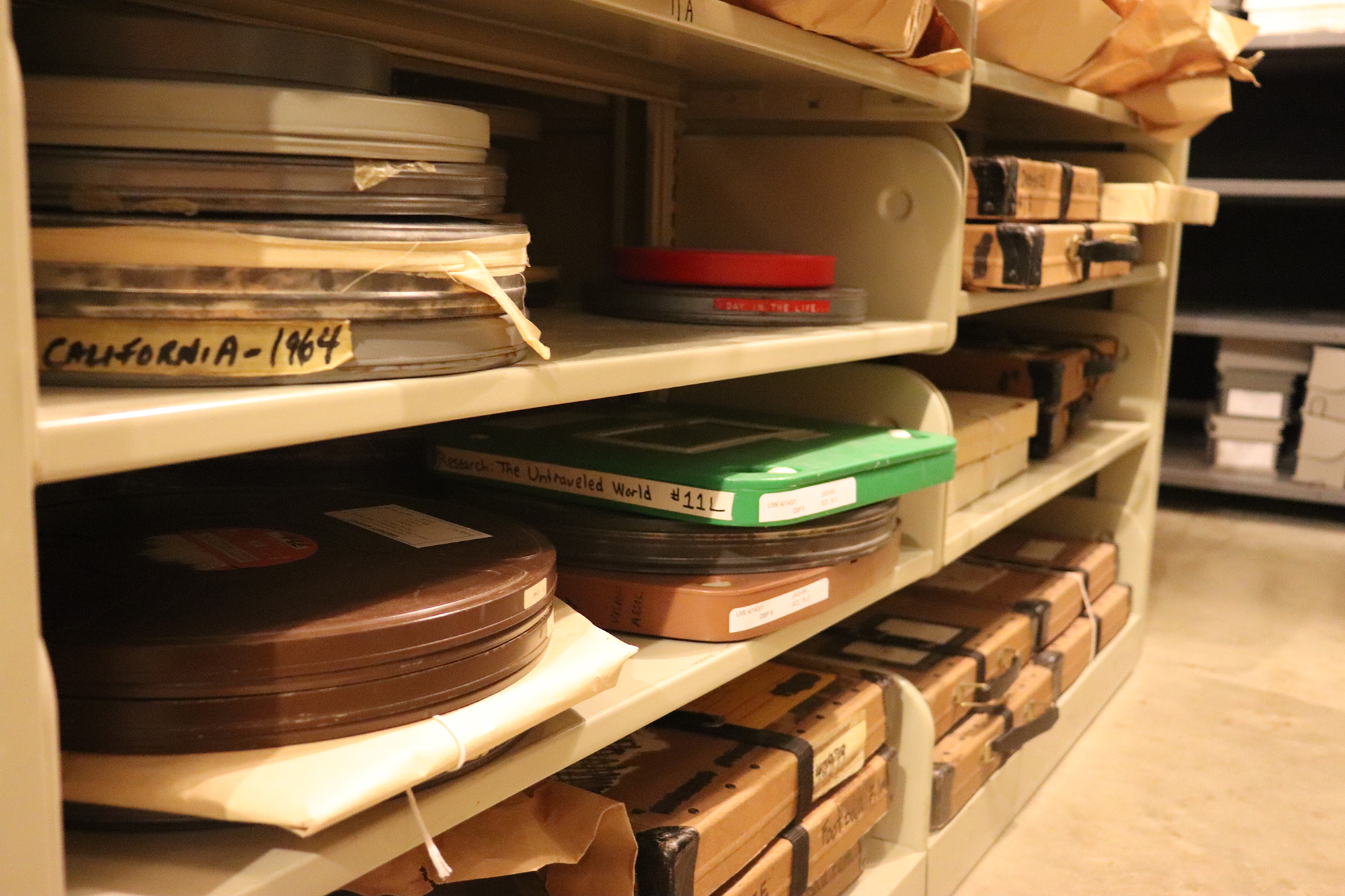 Film canisters in the old archives storage arrea in the basement of Lewis Hall. On Aug. 2, the University Archives began a long move to the second floor of Ellis Library.