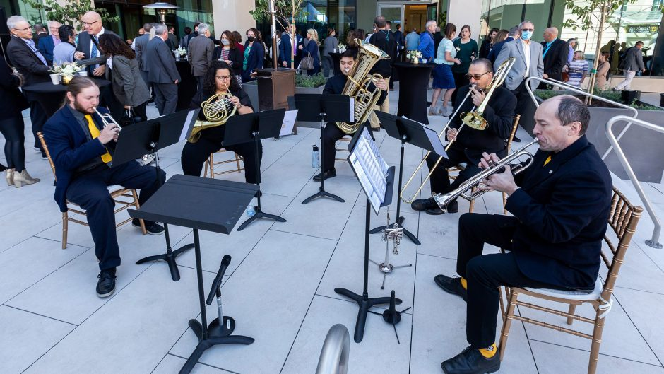 a brass quartet plays music outside at the event