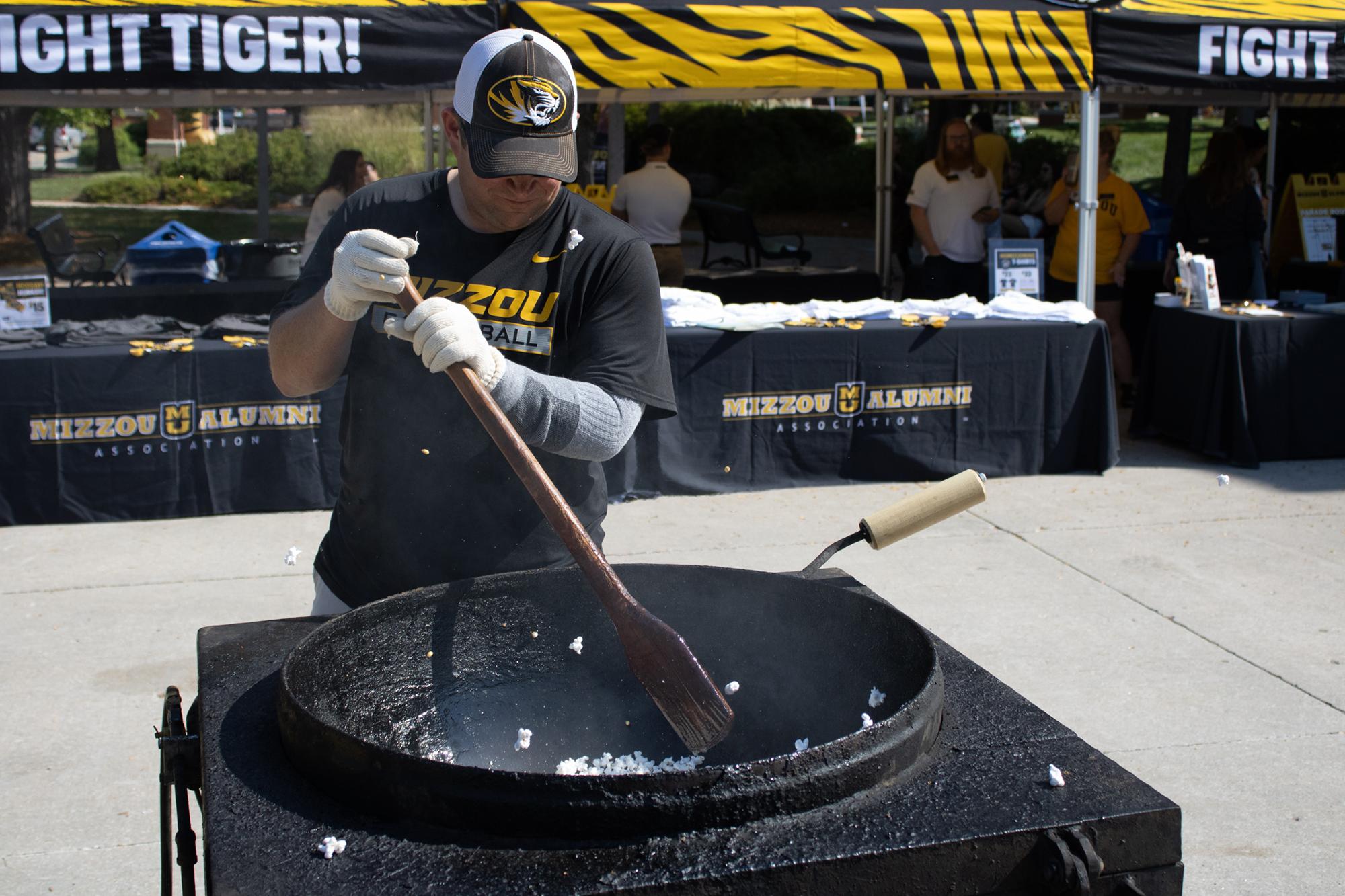 a man pops kettle corn