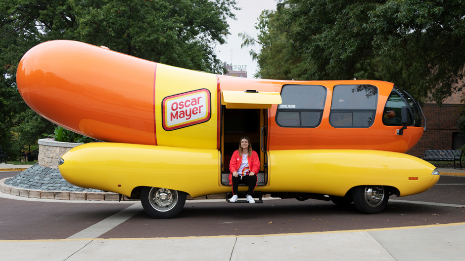 Picture of Ally Friend in front of the Oscar Meyer Wienermobile